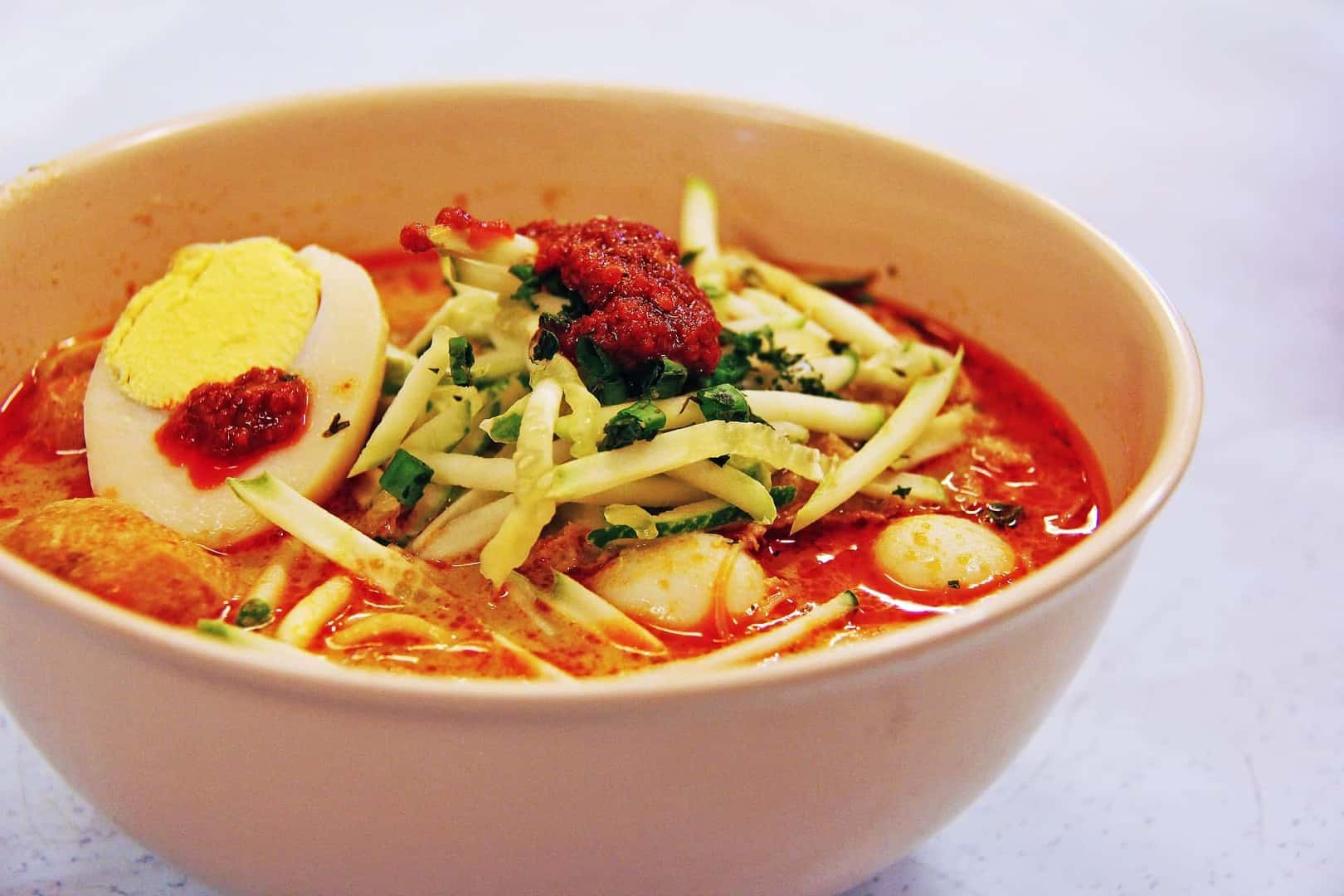 Laksa, a spicy noodle soup, is another favorite in Singapore