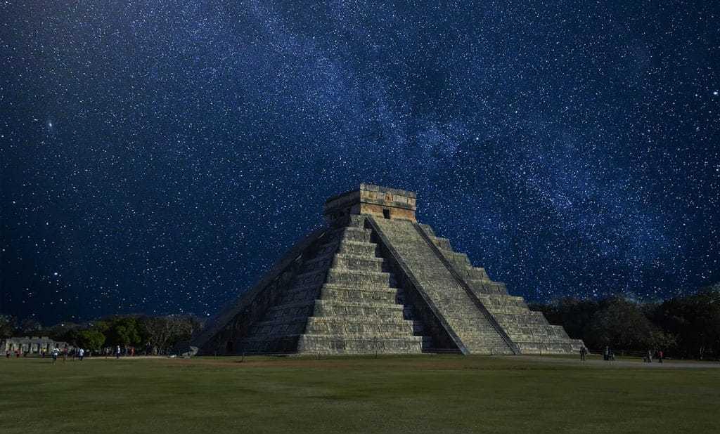 A night shot of the Chichen Itza Pyramid in Mexico